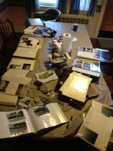 Dad's table, with albums and sorting piles
